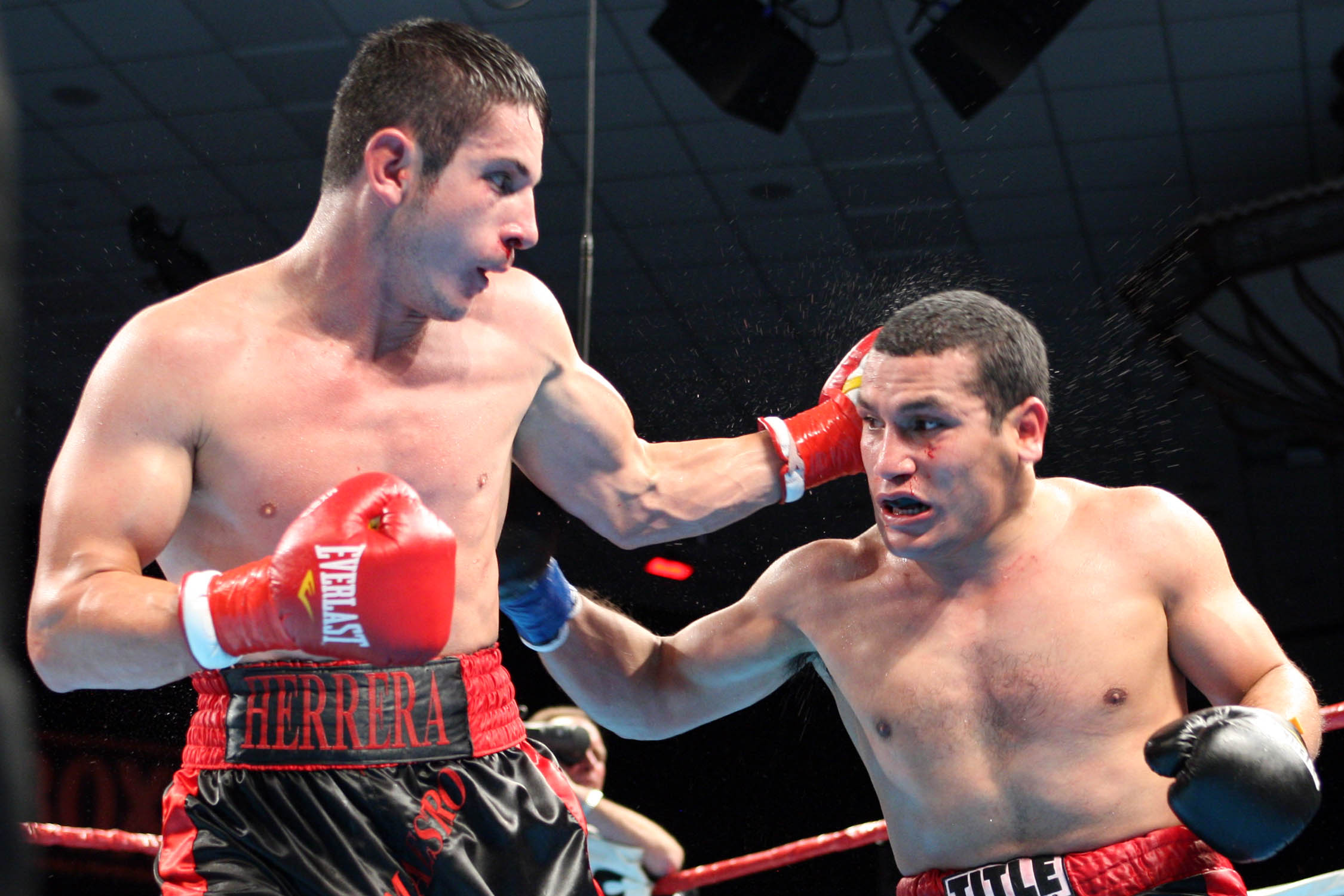 Anchondo, left, of La Puente , Calif. , improved 30-2 with the split decision. Scores were 77-75, 77-75 Anchondo, 79-73 Herrera