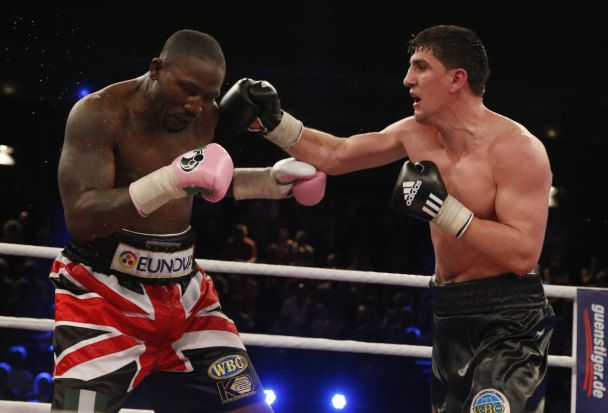 Marco Huck (r) lands right cross on Afolabi