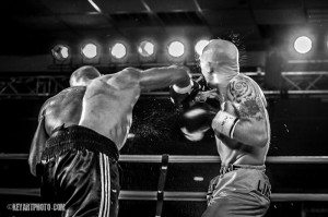 Kennedy (L.) lands the overhand right.