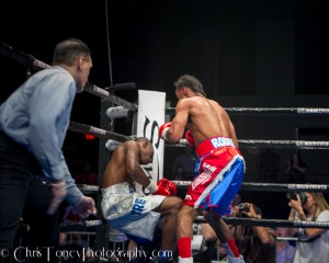 Rodriguez (R). watches as Wiggins sinks to the canvas.