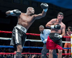 Goyco (L.) launching the left hook.