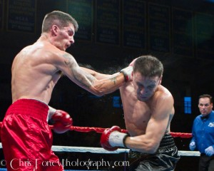 Marengo (R.) connecting with the overhand right.