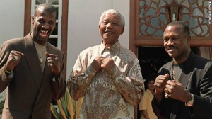 (Pretoria, South Africa – Dec. 6, 1997)  Michael Spinks, Mandela and Joe Frazier AFPGetty Images