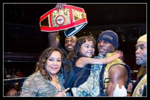 Livvy and Kennedy being held by her dad - the new USBA heavyweight champion.