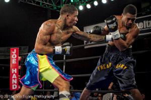 Smith (L.) punishes Jackson on the ropes.