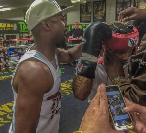 Mayweather coaching Gervonta Davis at Mayweather Boxing    Club.jpg5